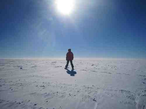 Looking away from the station with Brad standing under the sun.  The horizon basically looks like this in every direction; the South Pole is very flat and featureless.