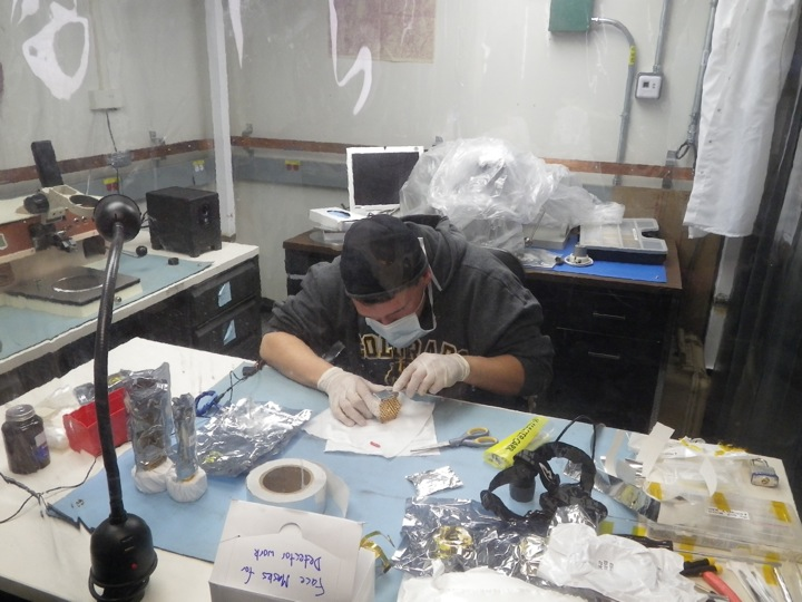 Jason Henning putting the finishing touches on the assembly of the 150 GHz modules.